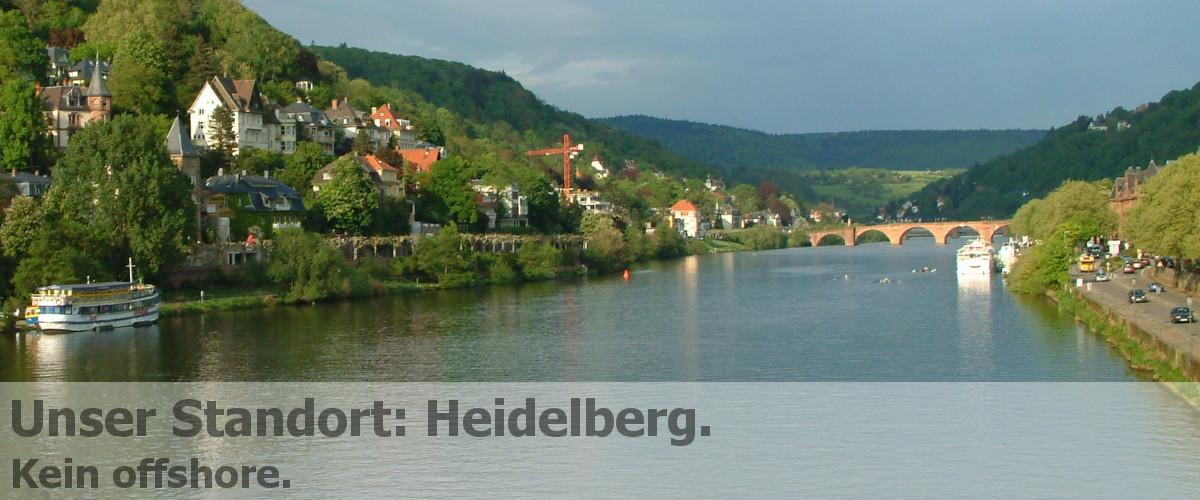 BitBumper Titel: Unser Standort ist Heidelberg und kein offshore Standort (Bild zeigt Stadtansicht Heidelberg mit Neckar und alter Brücke)